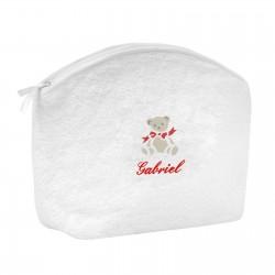 Trousse de toilette en éponge blanche brodée au prénom de l'enfant avec un petit ours.